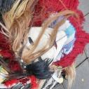 Topeng ini sebagai salah satu atribut yang dipakai; mirip topeng Guy Fawkes ya :)